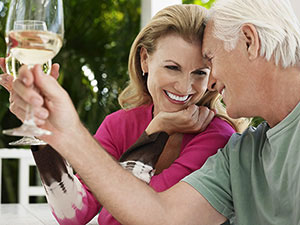 Middle aged couple drinking wine