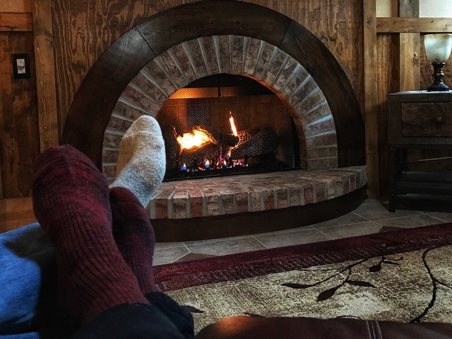 Snuggled up in front of cozy Hobbit fireplace